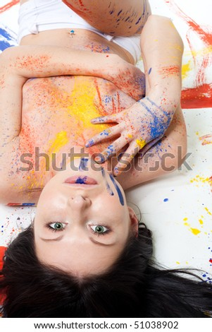 Portrait of beautiful woman smear with color paints - stock photo