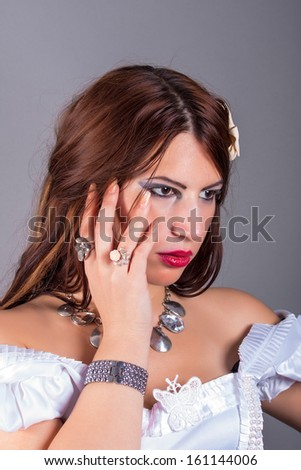 portrait of beautiful woman wearing rings and necklace - stock photo