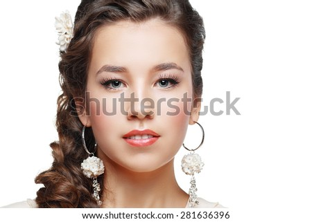 Portrait of Beautiful Woman Wedding Model Isolated on White Background. Advertising and Commercial Design. Shopping. Jewelry - Bridal Earrings, Hairstyle - stock photo