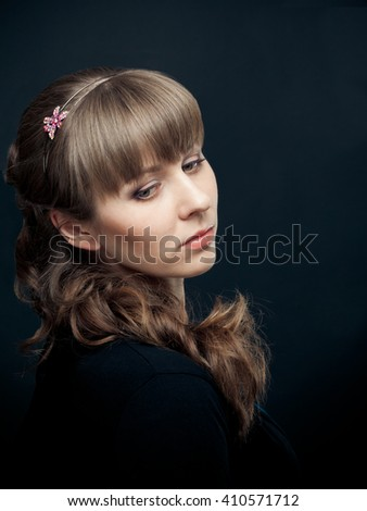Portrait of beautiful woman wih hairstyle on black background - stock photo