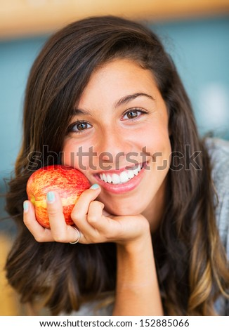 Portrait of beautiful woman with an apple, Healthy Lifestyle Concept