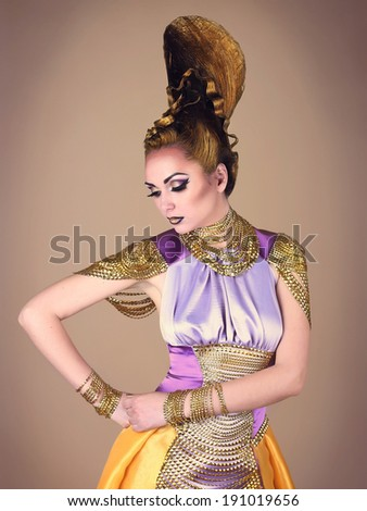 Portrait of beautiful woman with an unusual hairstyle in Egyptian style