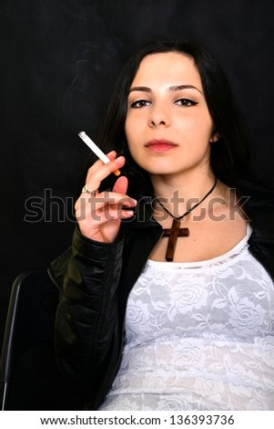 Portrait Of Beautiful Woman With Cigarette - stock photo