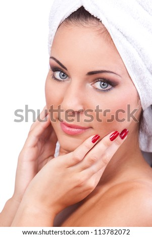 Portrait of beautiful woman with clean face with towel on her head - stock photo