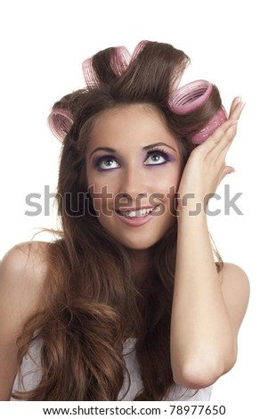 Portrait of beautiful woman with curlers