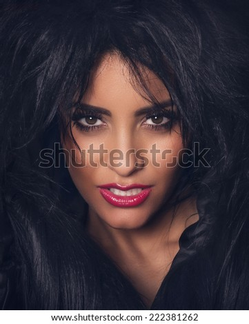 Portrait of beautiful woman with dark fur and red lips - stock photo