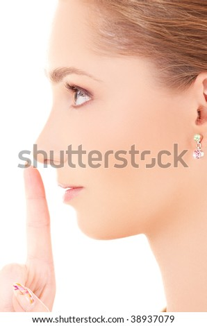 portrait of beautiful woman with finger on lips