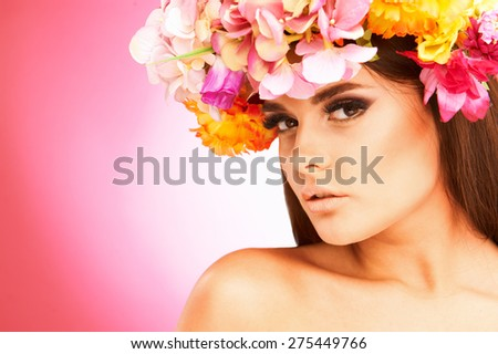 Portrait of beautiful woman with flower wreath. Space for text.
