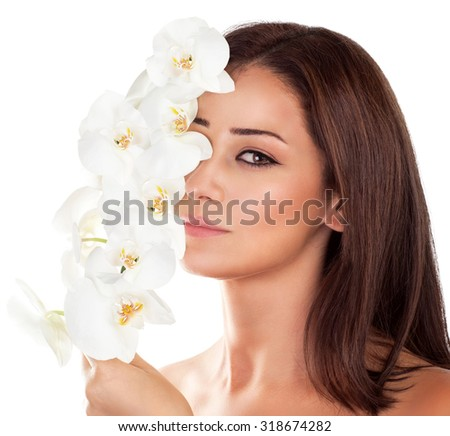 Portrait of beautiful woman with fresh orchid flowers on half of face isolated on white background, aroma therapy, enjoying day in luxury spa salon - stock photo