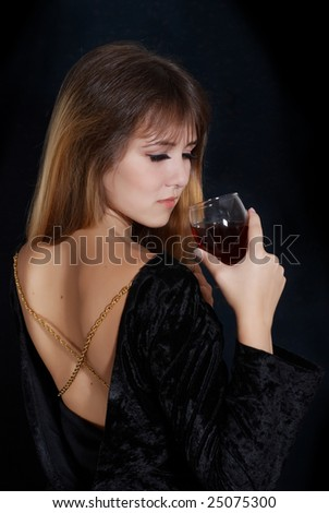 Portrait of beautiful woman with glass red wine - stock photo