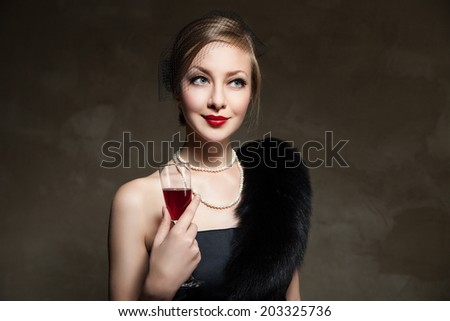 Portrait of beautiful woman with glass red wine. Retro style - stock photo