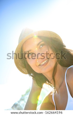 Portrait of beautiful woman with hat, light effect - stock photo