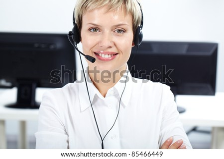 Portrait of beautiful woman with headset looking at camera and smiling