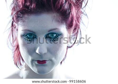 Portrait of beautiful woman with heavy makeup and cold light