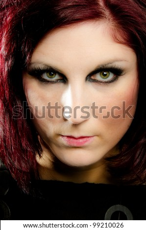 Portrait of beautiful woman with intense green eyes staring