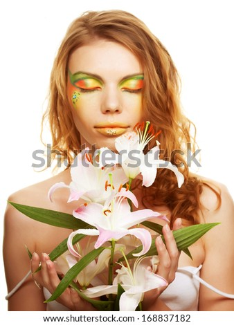 Portrait of Beautiful woman with lily - stock photo
