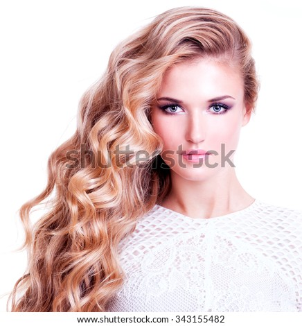 Portrait of beautiful woman with long blond curly hair. Fashion model posing at studio in white dress. Isolated on white background. - stock photo