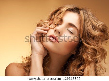 portrait of beautiful woman with long curly hair - stock photo