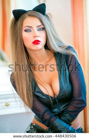 Portrait of beautiful woman with long hair in a black cat suit with deep decollete