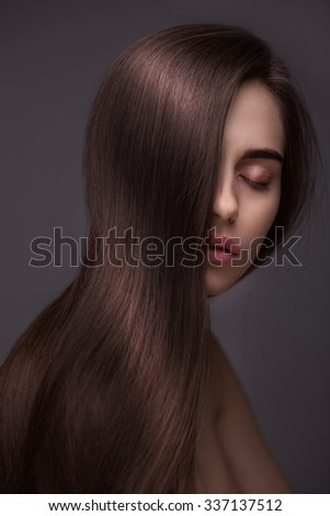 portrait of Beautiful Woman with Long Hair isolated over dark background - stock photo