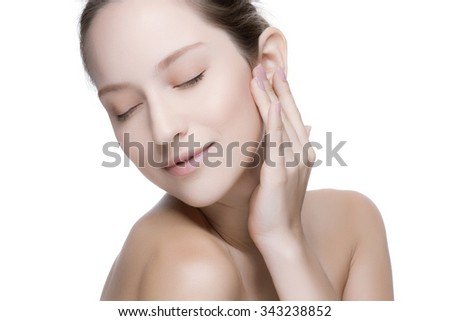 Portrait of beautiful woman with perfect skin and face on white background. - stock photo