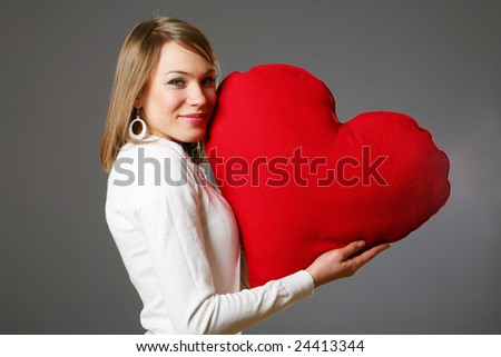 Portrait of beautiful woman with red heart
