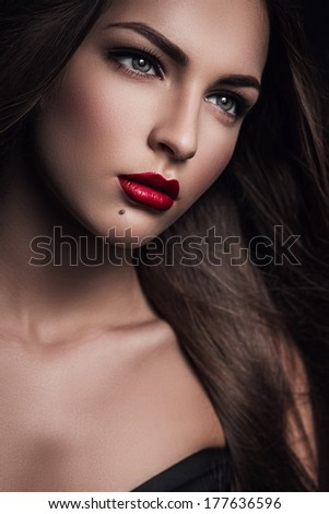 portrait of beautiful woman with red lips - stock photo
