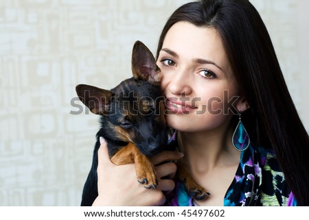 Portrait of beautiful woman with small dog - stock photo