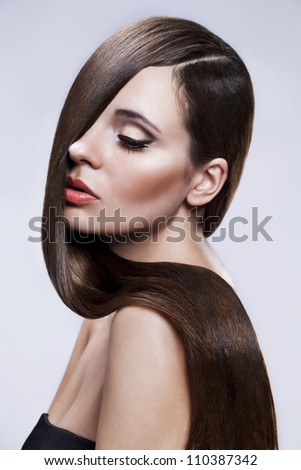 Portrait of Beautiful Woman with smooth gloss long hair. - stock photo