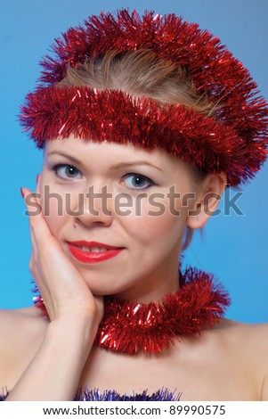 Portrait of beautiful woman with tinsel at Christmas - stock photo