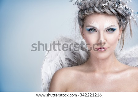 Portrait of beautiful woman with winter make up, snow queen - stock photo