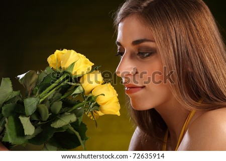 Portrait of beautiful woman with yellow roses - stock photo