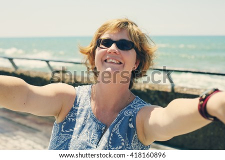 Portrait of beautiful 35 years old woman outdoors