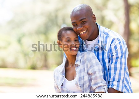 portrait of beautiful young african american couple outdoors - stock photo