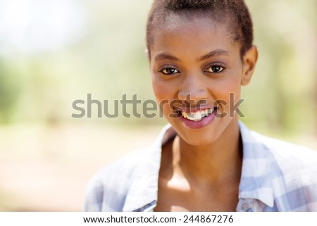portrait of beautiful young african woman outdoors - stock photo