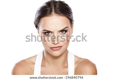 portrait of beautiful young angry woman - stock photo