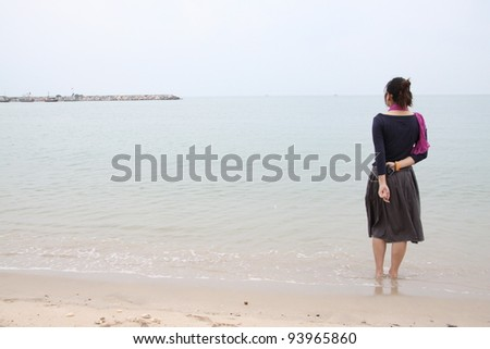 portrait of beautiful young asian woman on beach - stock photo