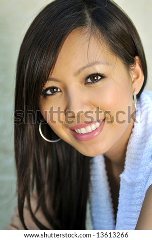 Portrait of beautiful young Asian woman smiling