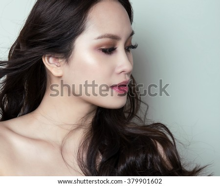 portrait of beautiful young asian woman with clear skin