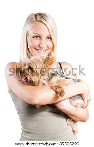 Portrait of Beautiful young blond girl holding cute yorkie, isolated on white background