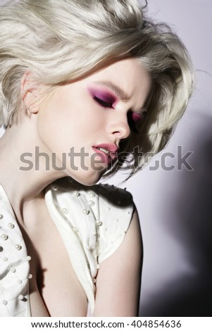 Portrait of beautiful young blond woman with clean face. Fresh makeup. Attractive sensual girl - stock photo