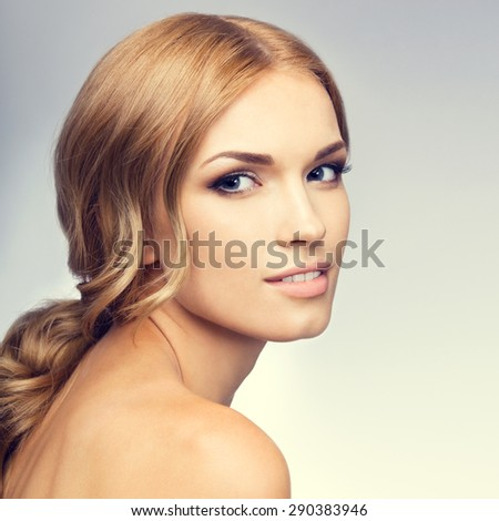 Portrait of beautiful young blond woman with naked shoulders. Beauty and health concept. - stock photo