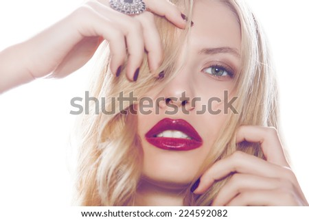 Portrait of beautiful young blonde girl in studio. Fashion photo