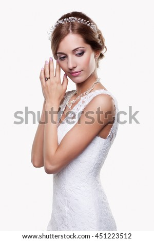 Portrait of beautiful young blonde woman bride in white Wedding Dress on light gray background - stock photo
