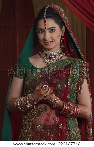 Portrait of beautiful young bride in traditional outfit - stock photo