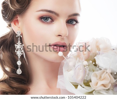 Portrait of beautiful young bride isolated on white background - stock photo
