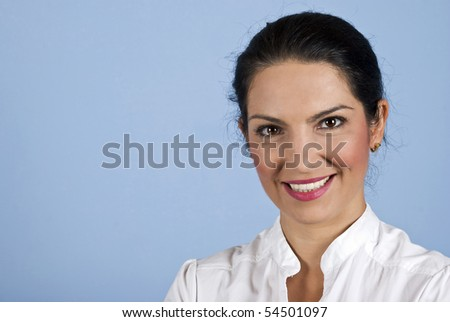 Portrait of beautiful young confident woman on blue background and copy space for text in left part of image - stock photo
