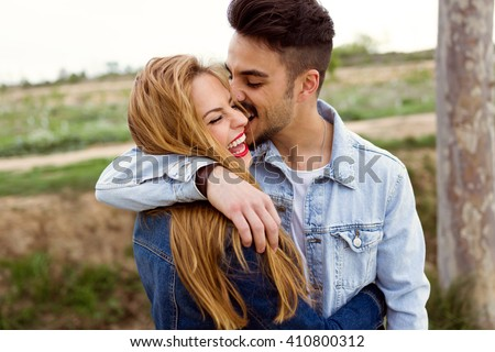 Portrait of beautiful young couple in love in the park.