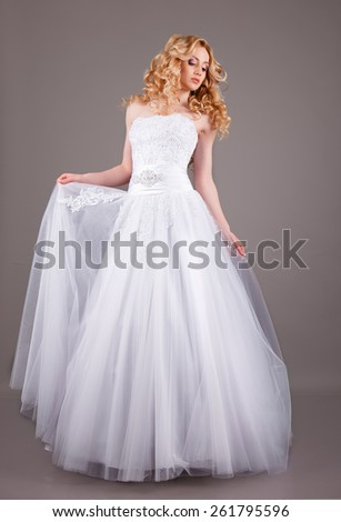 Portrait of Beautiful Young Fashion Bride .bride in white wedding dress on a gray background.Portrait of Beautiful Young Fashion Bride  - stock photo