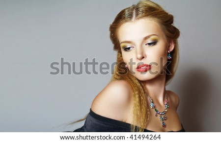 Portrait of beautiful young fashion model with long hair - stock photo